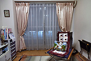 window curtains and chair with embroidery cushion interior of a residential house