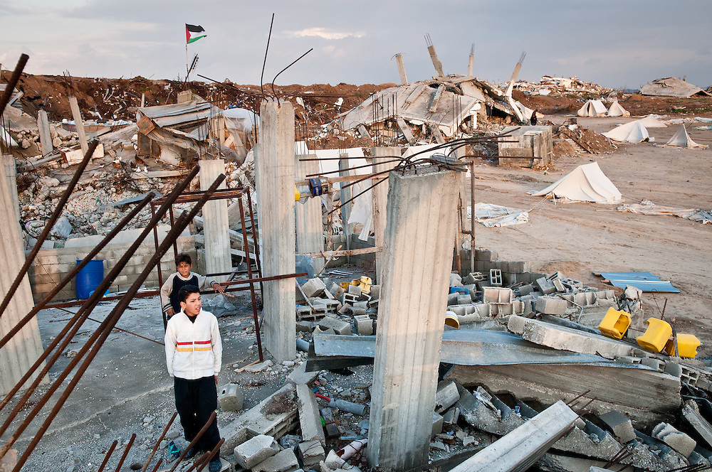 Jabaliya, Gaza Strip: Children stand amid the wreckage of homes in Jabaliya after Operation Cast Lead.