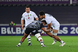 Clermont Auvergne's Sitaleki Timani is tackled by Ospreys' Ma'afu Fia - Mandatory by-line: Craig Thomas/JMP - 15/10/2017 - RUGBY - Liberty Stadium - Swansea, Wales - Ospreys Rugby v Clermont Auvergne - European Rugby Champions Cup