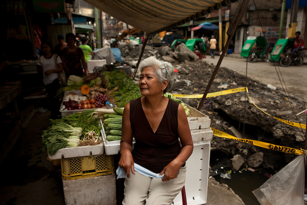 CASE. Rosalinda at the vegetable stall. Rosalinda Nuqui, 62. Rosalinda's daughter Rosaria died from an ectopic pregnancy. She had stomach aches for a week before she went to the hospital. She did not know that she was pregnant. Rosalina now cares for her grandchildren and runs her daughter's vegetable stall. China town, Manila, Philippines.