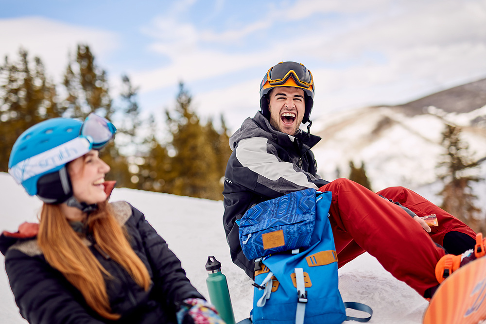 Snowboarders hanging out at Vail, Colorado