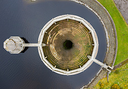 Aerial view of bellmouth spillway at Whiteadder reservoir in East Lothian. Scotland, UK.