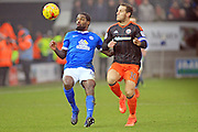Peterborough United midfielder Anthony Grant (42) and Sheffield United forward Billy Sharp (10) battle for the ball during the EFL Sky Bet League 1 match between Peterborough United and Sheffield Utd at London Road, Peterborough, England on 11 February 2017. Photo by Nigel Cole.