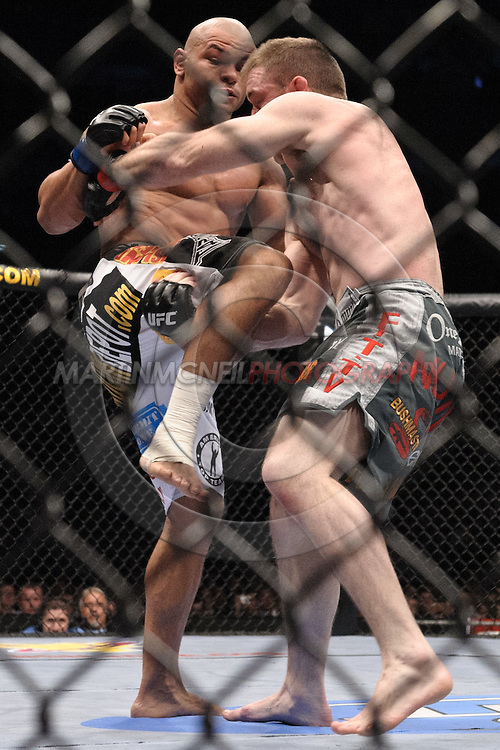 "LONDON, ENGLAND, JUNE 7, 2008: Thiago Alves (facing) throws a knee to the stomach of Matt Hughes during ""UFC 85: Bedlam"" inside the O2 Arena in Greenwich, London on June 7, 2008."