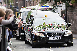 © Licensed to London News Pictures. 20/08/2015. Liverpool, UK. Picture shows members of the public throwing flowers on to Cilla Black's funeral cortege as it leaves St Mary's church in Liverpool. Photo credit: Andrew McCaren/LNP