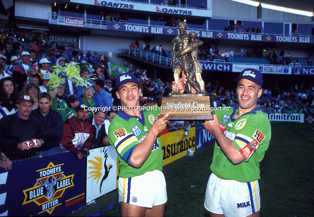 Ruben Wiki and Quentin Pongia celebrate with the Winfield Cup, Grand Final, Canberra Raiders v Canterbury Bulldogs, 1994. Photo: Andrew Cornaga/PHOTOSPORT