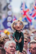 A puppet effigy of Theresa May at teh front - People's March for a People's Vote on the final Brexit deal.  Timed to coincide with the second anniversary of the 2016 referendum it is organised by anti Brexit, pro EU campaigners.