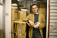 Tom, accountant in one of his two storage units in South East London. The larger one is used to store a couple of wardrobes he was given. The second one is full of boxes of books.