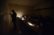 Aleppo, Syria, December, 2012 - A teacher holds class at the Al-Messarania Madrassa, a school that has continued to operate despite the fighting, despite the lack of electricity and water and temperatures around 30F degrees for most of the month.  The Madrassa holds 80 students divided in 6 classes.(Photo by Miguel Juárez Lugo)