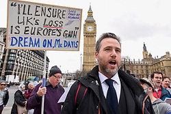 "© Licensed to London News Pictures. 29/03/2017. London, UK. Pro-Europe demonstrators stage a protest, led by (C) Simon Wallfisch, an opera baritone who performs Europe-wide.  The protestors paraded around Parliament Square singing the European Union anthem, ""Ode to Joy"".  Today, is the day that Article 50 is formally triggered, with a handwritten letter bearing the Prime Minister's signature being delivered to the European Union today. Photo credit : Stephen Chung/LNP"