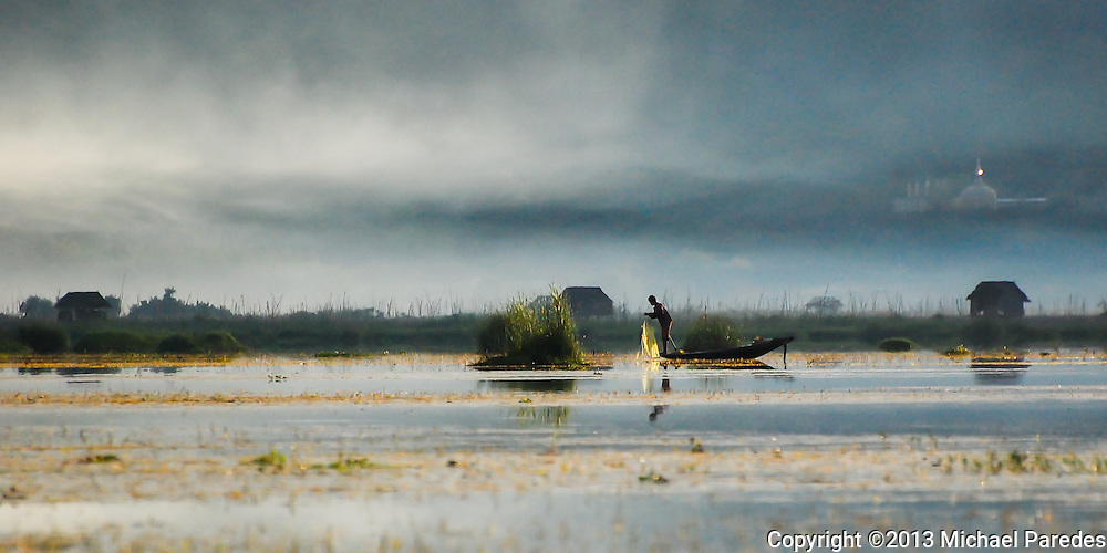 A fisherman in the early morning mist on Inlé Lake, Burma (Myanmar).