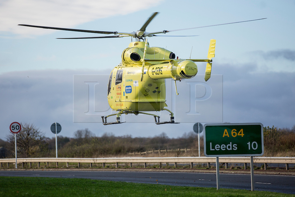 © Licensed to London News Pictures. 19/11/2015. Leeds UK. As Yorkshire continues to be battered by strong winds & flooding a lorry turns over on the A64 just outside Leeds, The driver was airlifted to hospital from the scene. Photo credit: Andrew McCaren/LNP
