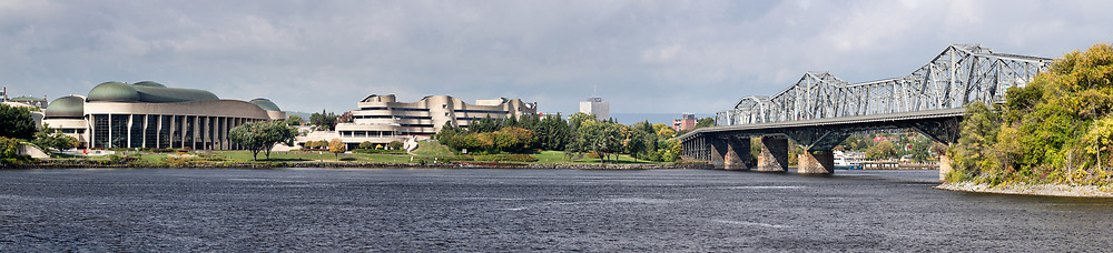 Canadian Museum of History (formerly the Canadian Museum of Civilization) and the Alexandra Bridge by the Ottawa River.  Canadian Museum of History is located in Gatineau, Québec.  Photographed where the Rideau Canal Locks meet the Ottawa River in Ottawa, Ontario, Canada.