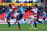Goal 3-1 Devante Cole of Doncaster Rovers jumps to head the ball but misses but comes off the foot of Jason McCarthy of Wycombe Wanderers to score own goal during the EFL Sky Bet League 1 match between Doncaster Rovers and Wycombe Wanderers at the Keepmoat Stadium, Doncaster, England on 29 February 2020.