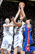 Jan 30, 2008; Manhattan, KS, USA; Kansas State Wildcats forward Michael Beasley (30) and teammate Darren Kent (42) reach for a rebound with Kansas Jayhawks forward Sasha Kaun (24) in the first half at Bramlage Coliseum in Manhattan, KS. Mandatory Credit: Peter G. Aiken-US PRESSWIRE