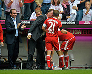 Trainer Louis van Gaal  gets some special treatment from  Daniel van Buyten (Bayern Munich (bending down) whilst shouting at Philip Lahm. Bundesliga, week 6, FC Bayern Munich v FC Nürnberg, Munich, Germany, 19.09.2009