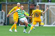 Robbie Crawford (#16) of Livingston FC tackles Scott Brown (#8) of Celtic FC during the Ladbrokes Scottish Premiership match between Livingston FC and Celtic FC at The Tony Macaroni Arena, Livingston, Scotland on 6 October 2019.