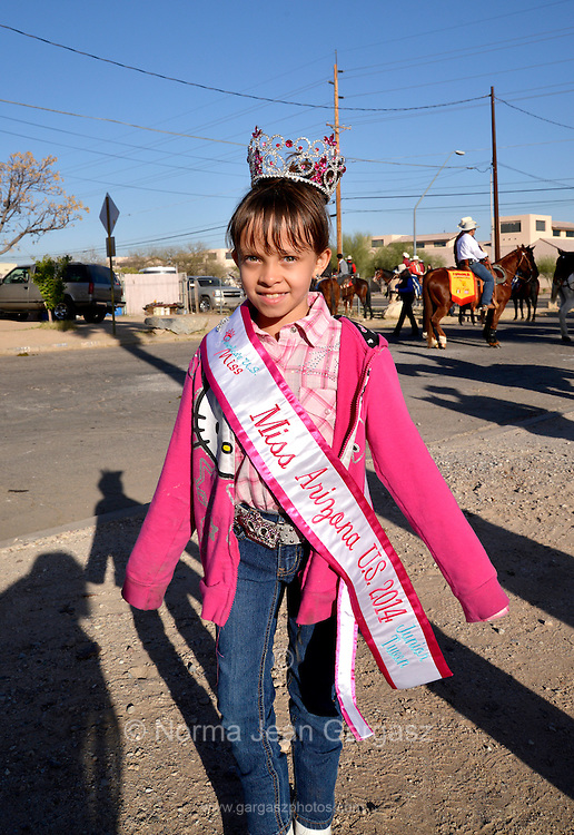 Gabriela Bustillos, 9, Miss Arizona in the Junior Tween Division, strikes a pose before joining the Tucson Rodeo Parade, the longest non-motorized parade in the nation. This 89-year-old event occurs each February in conjunction with La Fiesta de los Vaqueros, the Tucson Rodeo.  The event draws over 150,000 spectators in southern Tucson.