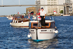 © Licensed to London News Pictures. 16/05/2015. London, UK. Dunkirk Little Ships parade in Royal Victoria Dock this evening. Over 20 Dunkirk Little Ships have gathered in London toay before leaving in the morning to continue their journey to Dunkirk to mark the 75th anniversary of the Dunkirk Evacuations. Photo credit : Vickie Flores/LNP
