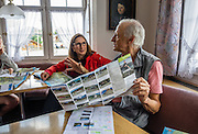 Tourists plan their trip at Hotel Cafe Adler, family-run since 1820, in Appenzell village, in Switzerland, Europe. Appenzell Innerrhoden is Switzerland's most traditional and smallest-population canton (second smallest by area). For licensing options, please inquire.