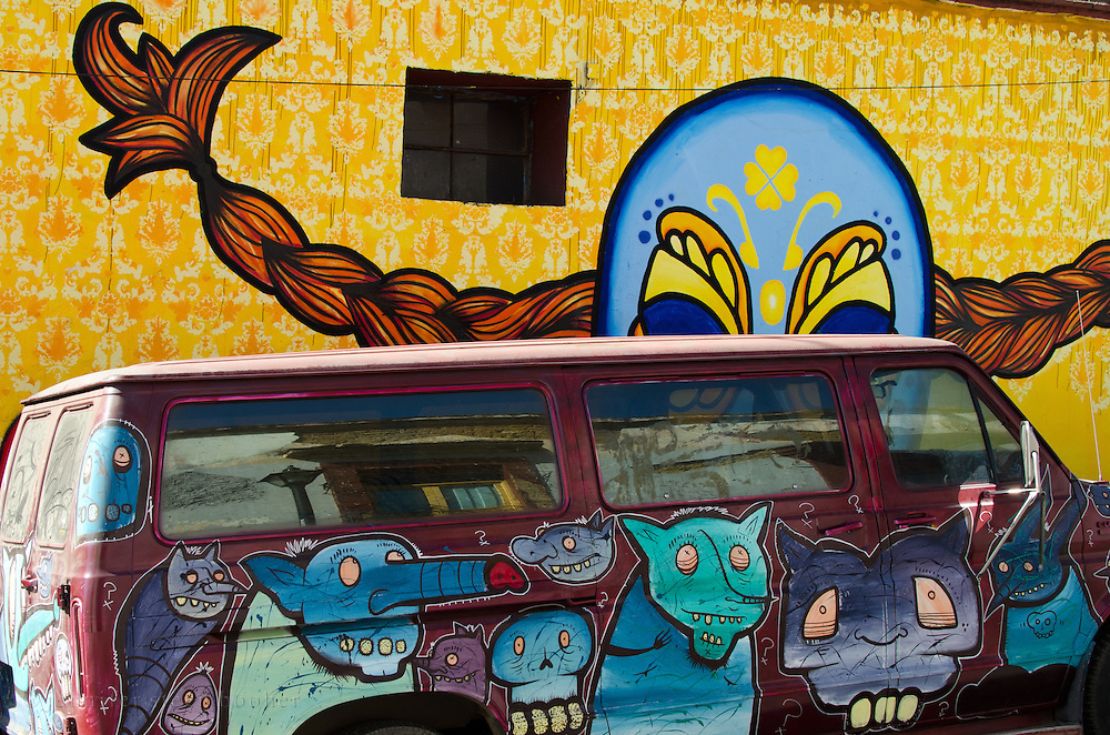 "Outside the Espacio Zapata gallery in Oaxaca, a mural of ""Luchadora Longstocking"" by the Kollektivet Livet looms over a van covered with monsters painted by the graffiti artist 'SCOM' (Society Creates all the Monsters.)"