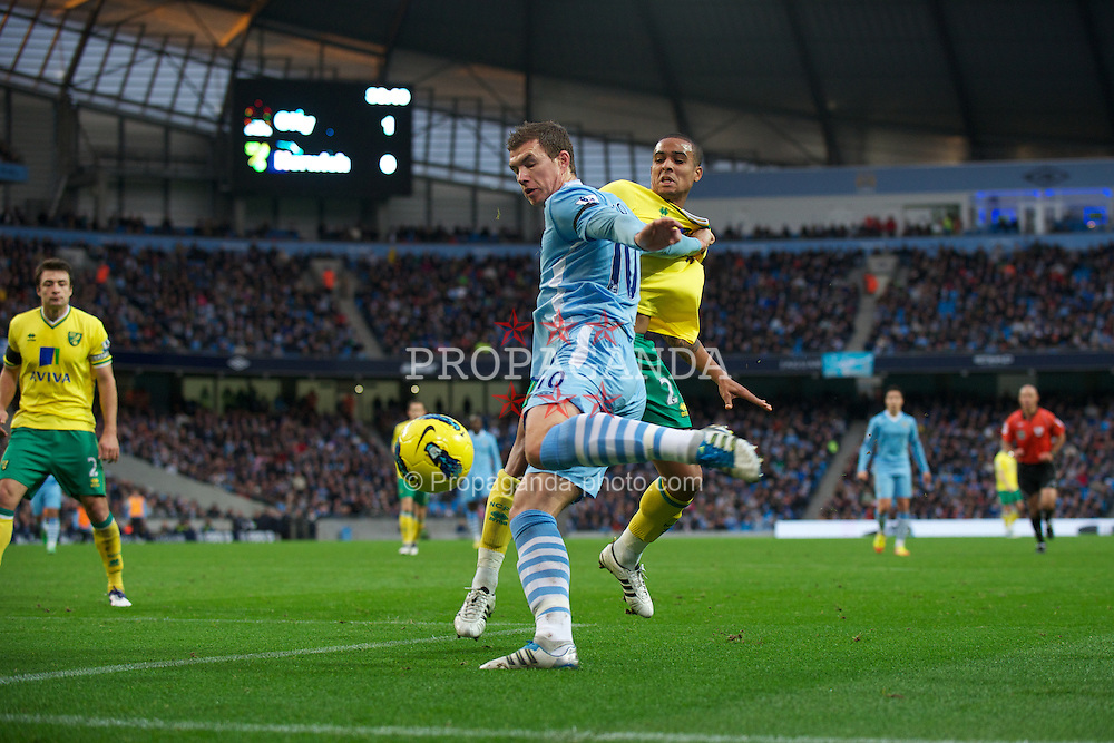 MANCHESTER, ENGLAND - Saturday, December 3, 2011: Manchester City's Edin Dzeko in action against Norwich City during the Premiership match at City of Manchester Stadium. (Pic by David Rawcliffe/Propaganda)