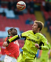 LONDON, ENGLAND - Saturday, January 30, 2010: Charlton Athletic's Sam Sodje and Tranmere Rovers' Ian Moore in action during the Football League One match at the Valley. (Photo by Gareth Davies/Propaganda)