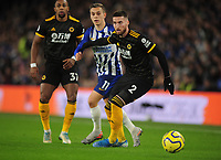 Football - 2019 / 2020 Premier League - Brighton & Hove Albion vs. Wolverhampton Wanderers<br /> <br /> Matt Doherty of Wolves and Leandro Trossard of Brighton, at The Amex.<br /> <br /> COLORSPORT/ANDREW COWIE