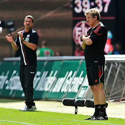 24.07.2010, Fritz-Walter Stadion, Kaiserslautern, GER, 1. FBL, Friendly Match, 1.FC Kaiserslautern vs FC Liverpool, im Bild Marco KURZ (Trainer Kaiserslautern) ist zufrieden, Roy HODGSON (Trainer Liverpool) eher nicht, EXPA Pictures © 2010, PhotoCredit: EXPA/ nph/  Roth+++++ ATTENTION - OUT OF GER +++++