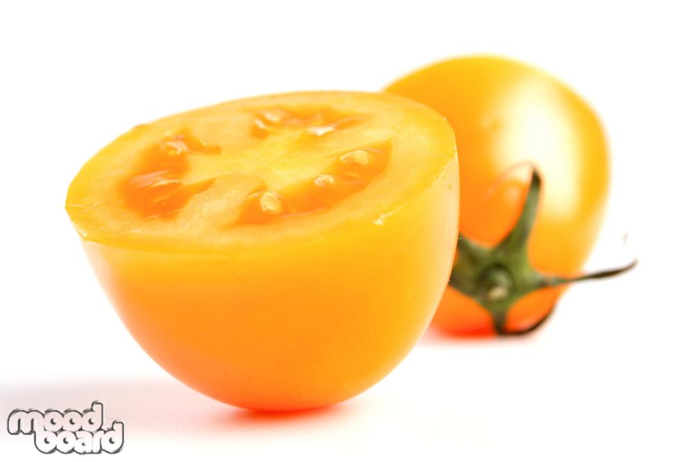 Close up of halved yellow tomato