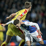 Tom Lawrence (Blackburn Rovers) gets an unintentional clip around the head while jumping for the ball during the Sky Bet Championship match between Blackburn Rovers and Rotherham United at Ewood Park, Blackburn, England on 11 December 2015. Photo by Mark P Doherty.
