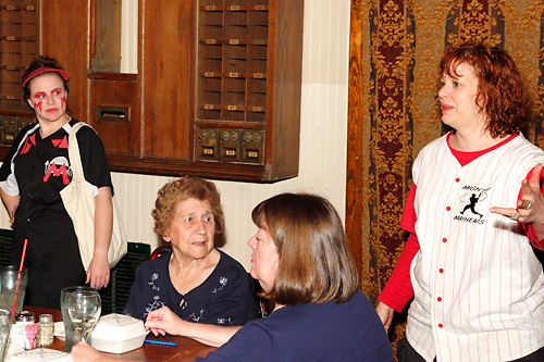 "(from left) Heather Gorby as Charlotte Screamer, Elizabeth Kinney of St. Petersburg, Florida, Nancy Gamblin of Waynesville and  Tamra Francis as Lee Pepper during Mayhem & Mystery's production of ""Baseball Battle"" at the Spaghetti Warehouse in downtown Dayton, Monday, May 7, 2012. Kinney is celebrating her 91st birthday at the show."