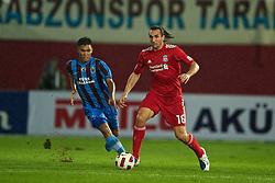 TRABZON, TURKEY - Thursday, August 26, 2010: Liverpool's Sotirios Kyrgiakos and Trabzonspor's Teofilo Gutierrez during the UEFA Europa League Play-Off 2nd Leg match at the Huseyin Avni Aker Stadium. (Pic by: David Rawcliffe/Propaganda)