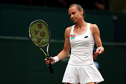 Magdalena Rybarikova reacts during her match against Garbine Muguruza on day ten of the Wimbledon Championships at The All England Lawn Tennis and Croquet Club, Wimbledon.