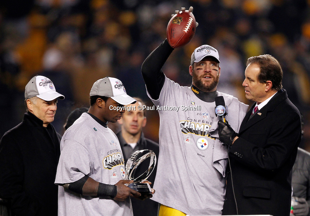 Pittsburgh Steelers quarterback Ben Roethlisberger (7) holds up a football in celebration as he talks to sportscaster Jim Nantz  (right) during the postgame trophy presentation after winning the NFL 2011 AFC Championship playoff football game against the New York Jets on Sunday, January 23, 2011 in Pittsburgh, Pennsylvania. The Steelers won the game 24-19. (©Paul Anthony Spinelli)