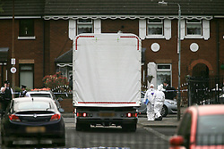 © Licensed to London News Pictures. 10/05/2016. Belfast, Northern Ireland, Forensic Science truck removes a car from  the area of Lady Street in west Belfast following the shooting of a man in his 50's late Monday evening. Dan Murray, a takeaway delivery driver, had been taking an order to Lady Street, near Grosvenor Road, when he was shot at about 22:15 BST on Monday. Murder victim Dan Murray had survived a previous gun attack in May 2015. This was the 3rd shooting within 24 hours.  Photo credit : Paul McErlane/LNP