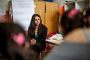 Romina Kajtazova - working as a paralegal for NGO Kham -teaching a workshop related to Roma health issues - in a kindergarden located in the city of Vinica in Macedonia during  the European Immunization Week. Almost all attending women are from the local Roma community.