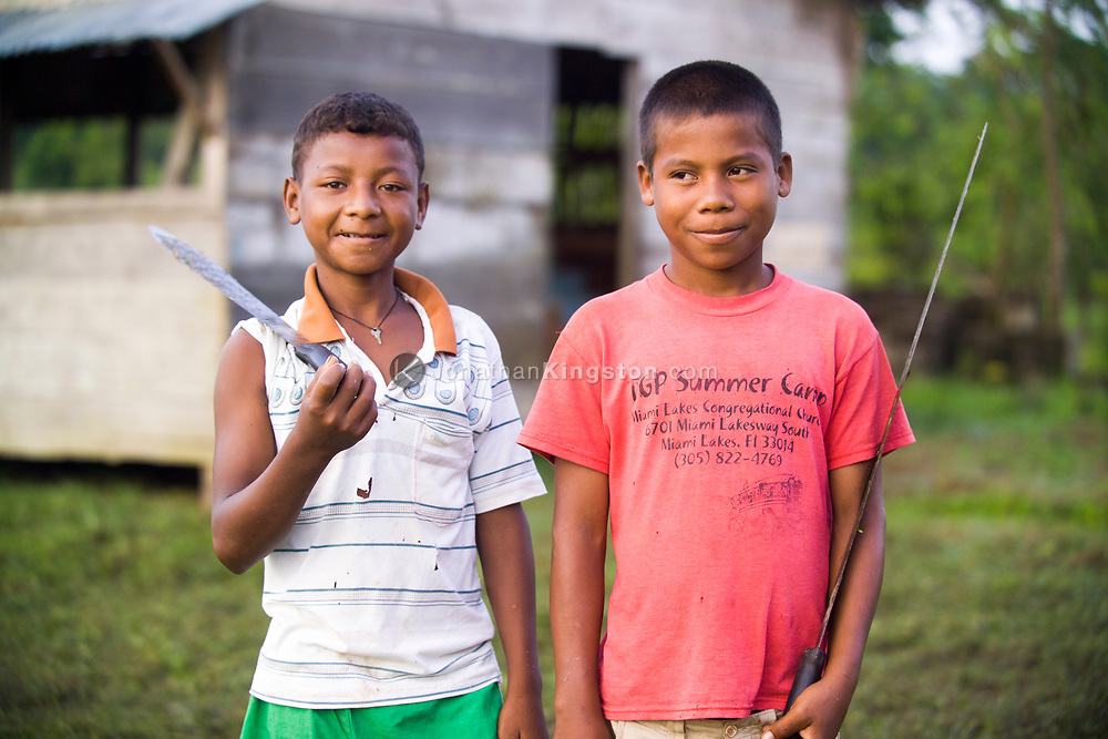 Portrait of two young Miskito boys holding machetes in Krin Krin, Nicaragua.