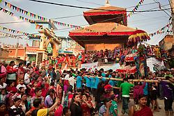 Spectators cheer as the Kumari of Tokha approaches.