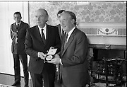 Charles Haughey Receives Seal Of Office.   (T3)..1989..12.07.1989..07.12.1989..12th July 1989..After winning the General Election and having been elected Taoiseach by a majority in Dail Eireann, Charles Haughey went to Aras an Uachtarain to avvept the seal of office. The seal of office was granted by President Patrick Hillery...Image shows President Patrick Hillery and An Taoiseach, Charles Haughey,proudly displaying the seal of office to the waiting media.