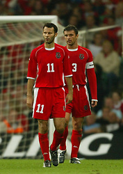 CARDIFF, WALES - Wednesday, September 10, 2003: Wales' Ryan Giggs and Gary Speed dejected after Finland equaliser during the Euro 2004 qualifying match at the Millennium Stadium.. (Photo by David Rawcliffe/Propaganda)