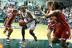 20 March 2010: Surrounded by by Bears, Philana Greene pushes towards the goal. The Flying Dutch of Hope College fall to the Bears of Washington University 65-59 in the Championship Game of the Division 3 Women's NCAA Basketball Championship the at the Shirk Center at Illinois Wesleyan in Bloomington Illinois.