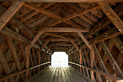 Trusses and beams in geometric shapes at The Old Covered Bridge, also known as Upper Sheffield Covered bridge by Sheffield Plain, Massachusetts.