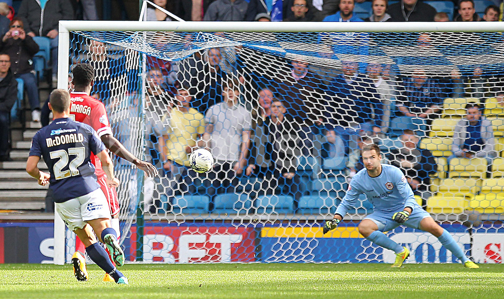 Millwall Scott McDonald shoots at goal during the Sky Bet Championship match between Millwall and Cardiff City at The Den, London, England on 25 October 2014. Photo by Phil Duncan.
