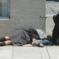 A homeless woman takes a nap on Santa Monica Blvd. on Wednesday, June 6, 2007.