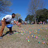 Thomas Wells | BUY at PHOTOS.DJOURNAL.COM<br /> University of Mississippi student Brandon Bagwell of Sardis helps spread out the eggs around the 3-4 year old field before Saturday's annual Easter Egg Hunt gets underway.