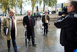 © London News Pictures. 04/11/2015. London, UK. Chip shop owner BARRY BEAVIS  (second left) arriving at the Supreme Court in London where a judge at the UK's highest court ruled against him in a over parking charges case. Beavis, from Chelmsford, Essex, was challenging private parking operators who charged him £85 for overstaying his two hours of free parking. Photo credit: Ben Cawthra/LNP