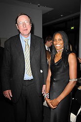 SOIYA GECAGA and SIR MAX HASTINGS at a dinner in aid of Save The Rhino held at The Battlebridge Room, Kings Place, London N1 on 20th October 2010.