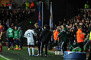 Swansea city's Nathan Dyer is injured and is consoled by his manager Garry Monk as he leaves the field. UEFA Europa league match , Swansea city v Napoli at the Liberty Stadium in Swansea, South Wales on Thursday 20th Feb 2014. pic by Andrew Orchard, Andrew Orchard sports photography.