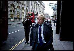 The London Mayor Boris Johnson walking in the City on his way to Liverpool Street Station to catch a train to Stamford Hill, London, Thursday April 5, 2012. Photo By Andrew Parsons/ i-Images...